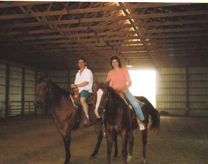 Mom and Dad on a horse